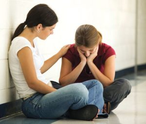 Parent consoling teen